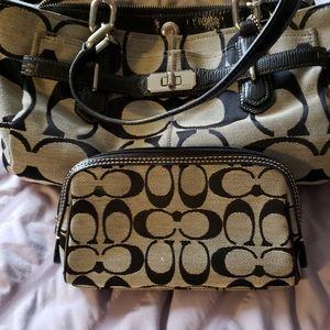 Coach purse with makeup bag